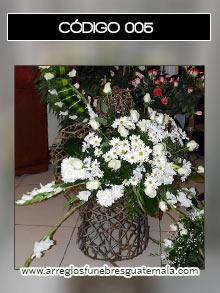 arreglos funebres de angeles con flores bellas para funerales